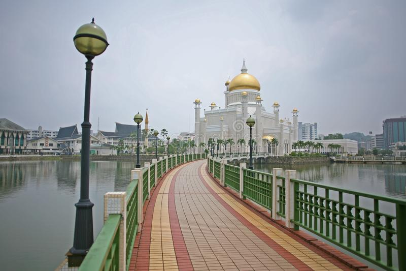 Pathway to the gold and marble of Brunei Omar Ali Saifuddien Mosque royalty free stock images