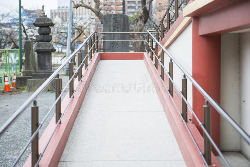 Pathways for wheelchair user to building. Architecture stock images