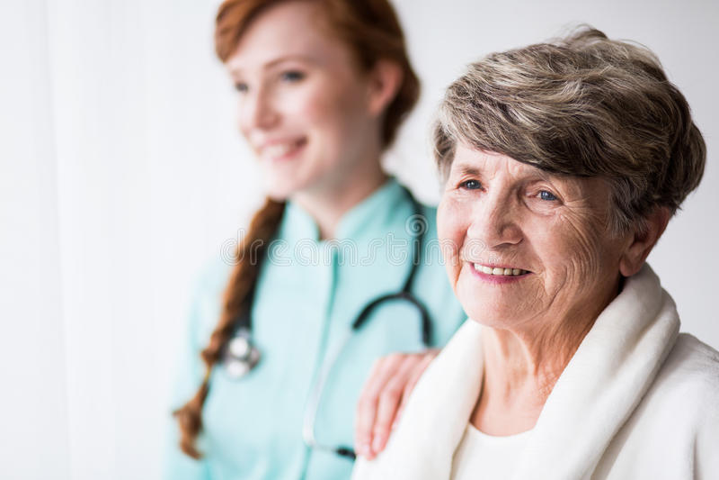 Patiënt en Arts stock afbeeldingen
