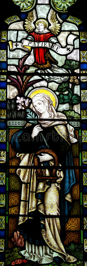 Patience in stained glass. A photo of Patience in stained glass royalty free stock image
