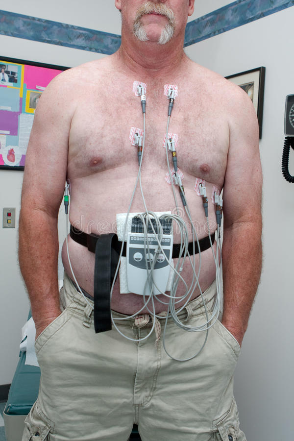 Patient attached to 12-lead EKG royalty free stock photo