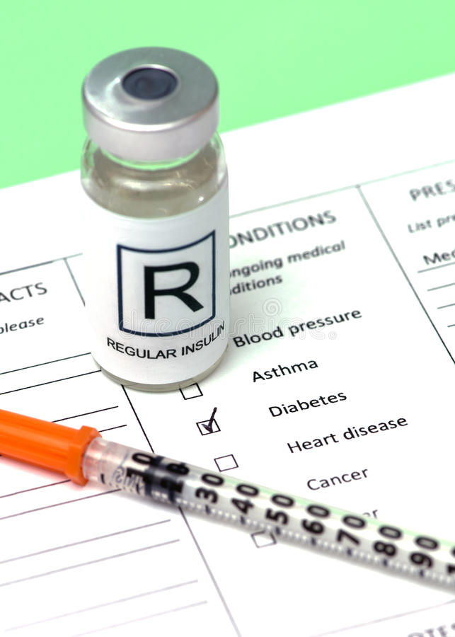 Patient Chart. Diabetic patient chart with regular insulin and syringe stock photo