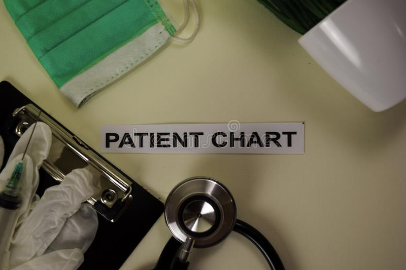 Patient Chart with inspiration and healthcare/medical concept on desk background royalty free stock images