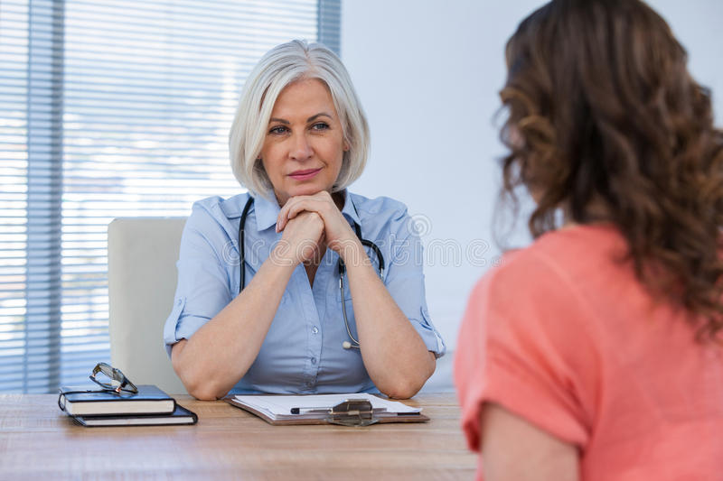 Patient consulting a doctor royalty free stock photo