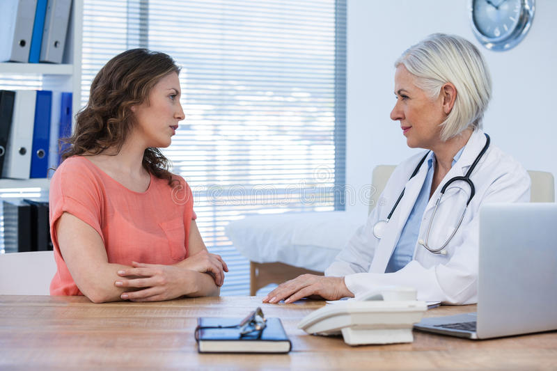 Patient consulting a doctor stock photos