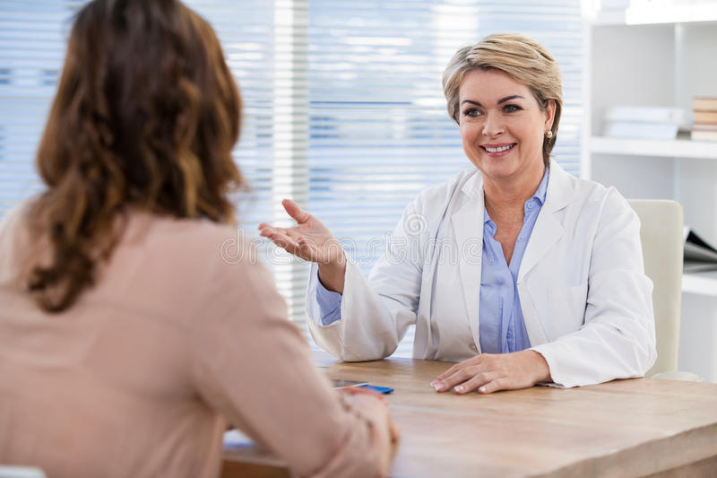 Doctor Consulting With Senior Woman Stock Image Image Of
