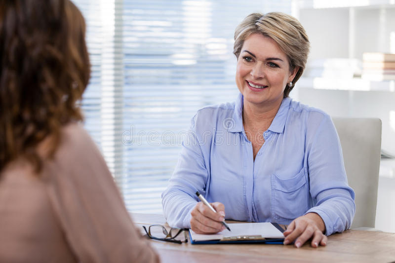 Patient consulting a doctor royalty free stock images