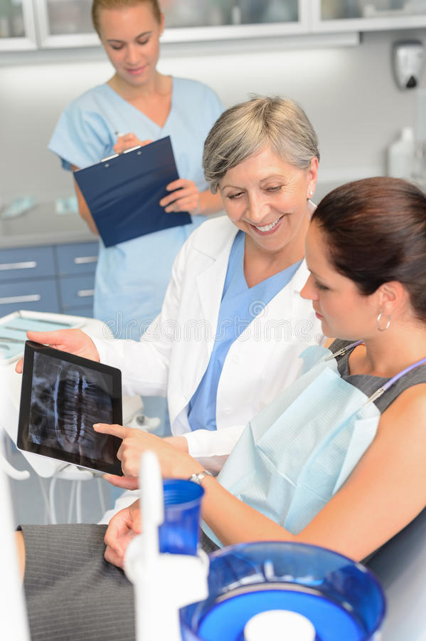 Patient at dental surgery dentist show xray tablet. Woman patient at dental surgery dentist show teeth xray tablet stock images
