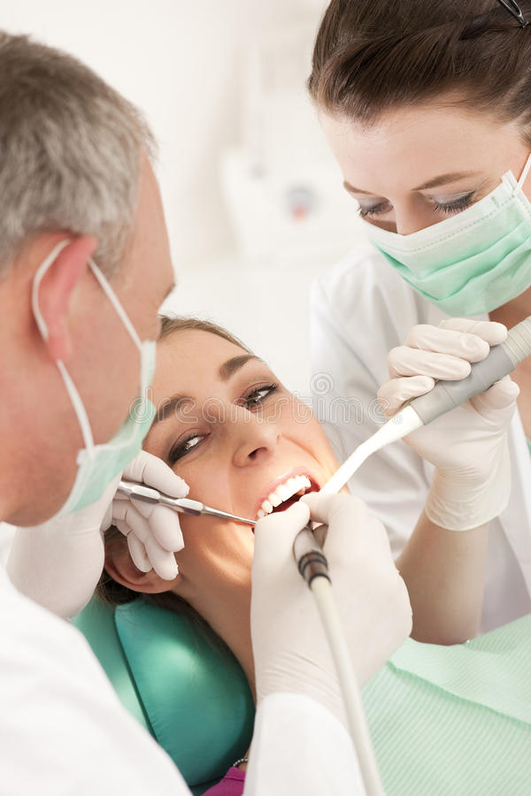 Patient with Dentist - dental treatment stock photography