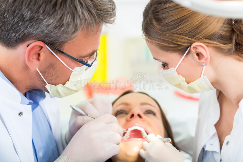 Patient with Dentist - dental treatment stock photos