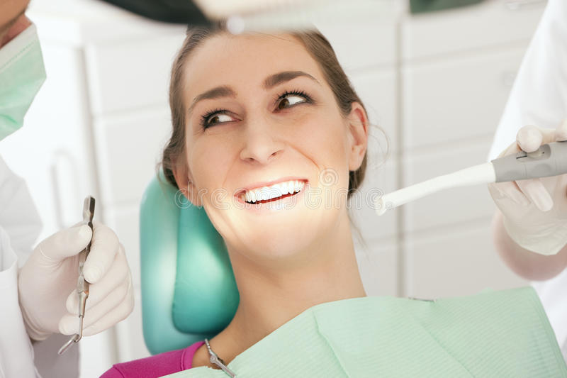 Patient with Dentist - no need to drill royalty free stock photo
