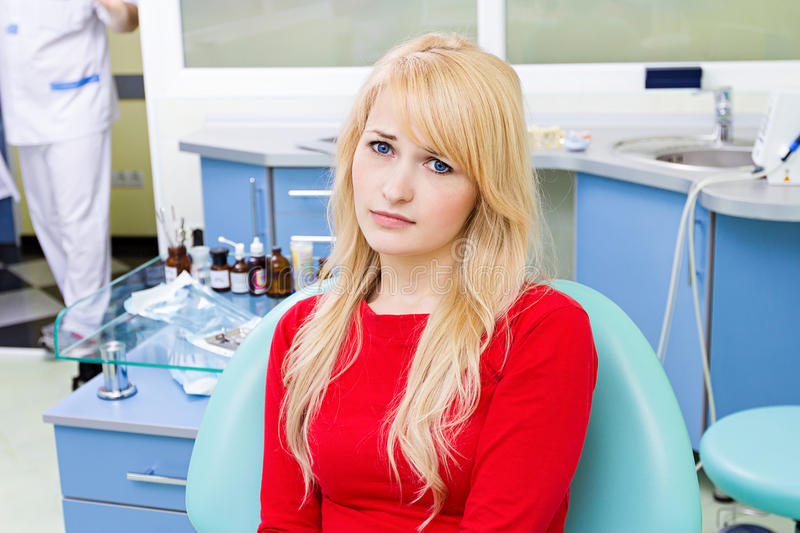 Patient in dentist office waiting dental procedure to be done stock photography