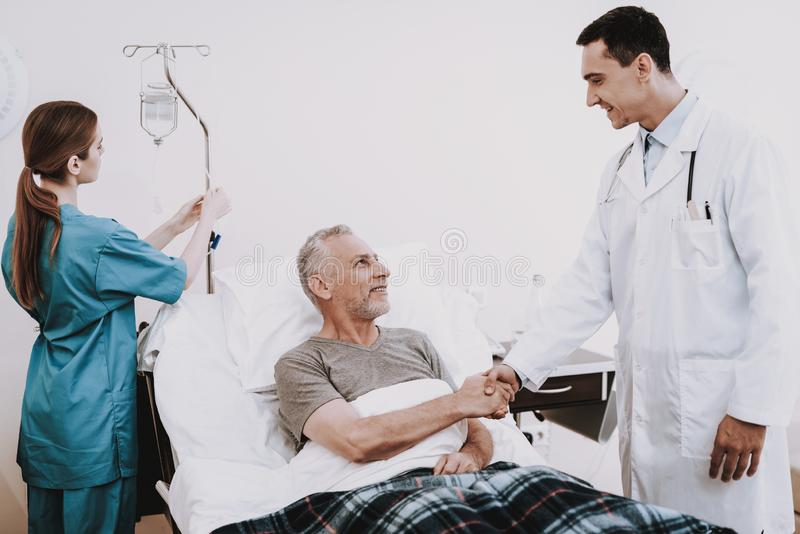Doctor and Patient in Hospital. Nurse and old Man. Patient and Doctor in White Room. Nurse and Doctor with Patient. Doctor in Clinic. Doctor in Hospital with royalty free stock photos