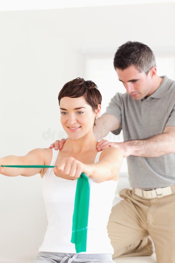 Free Patient Doing Some Exercises Under Supervision Stock Image - 21013331