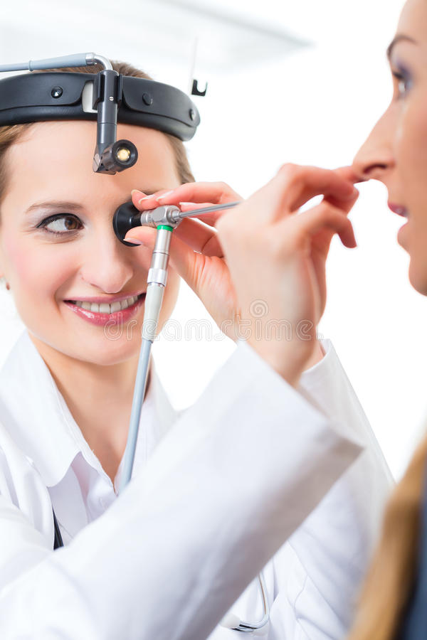 Patient in a examination by doctor in clinic royalty free stock photography