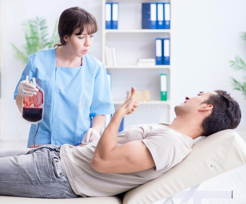 The patient getting blood transfusion in hospital clinic stock photo