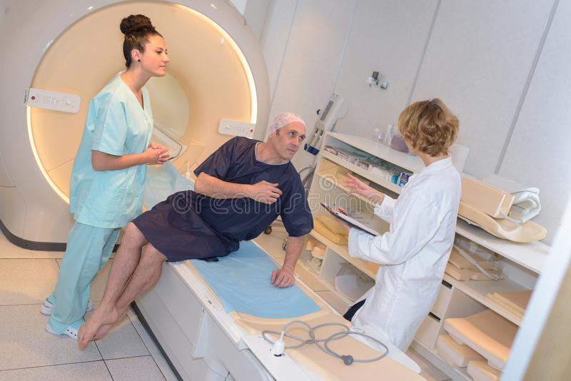 Patient getting up after mri examination royalty free stock images