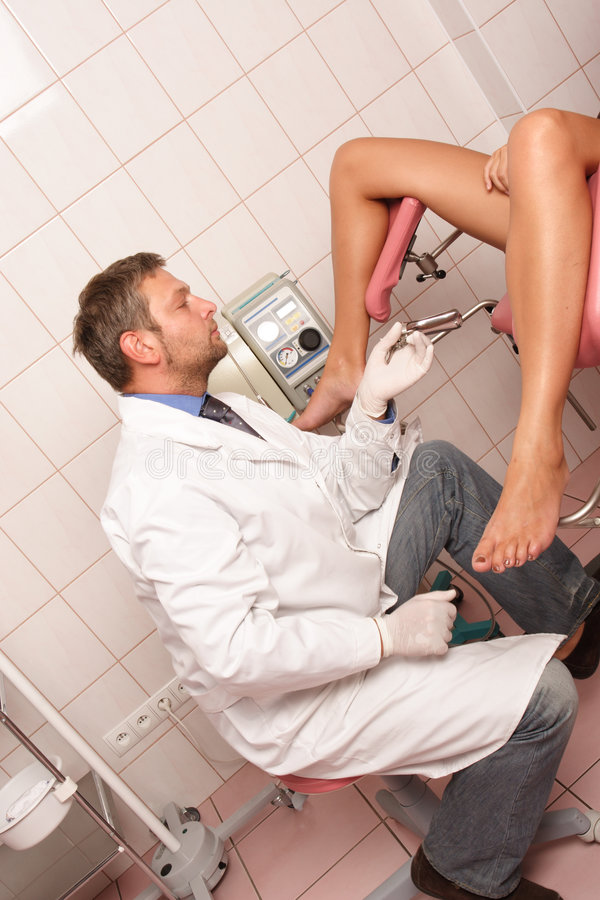 Patient at gynecologist examination stock images