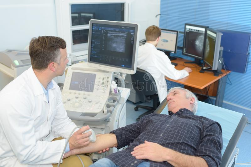 Patient having arm ultrasound royalty free stock photo