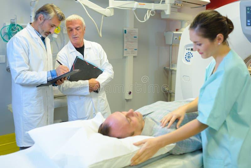 Patient having mri scan being reassured by nurse stock image