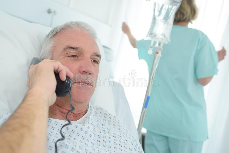 Patient in hospital bed on telephone royalty free stock photos