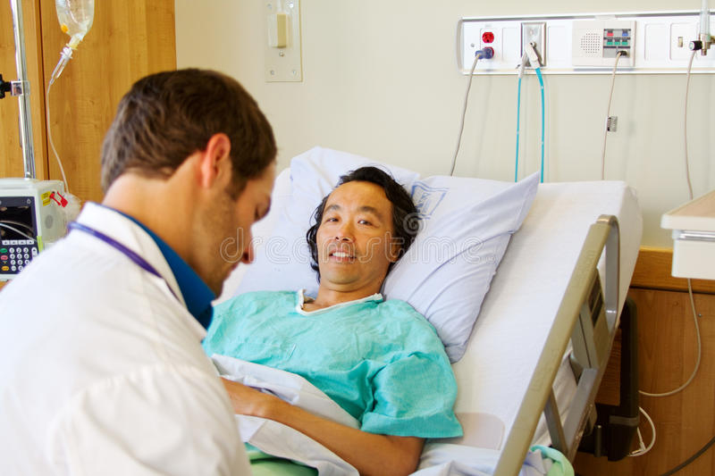 Patient laying in bed royalty free stock photography