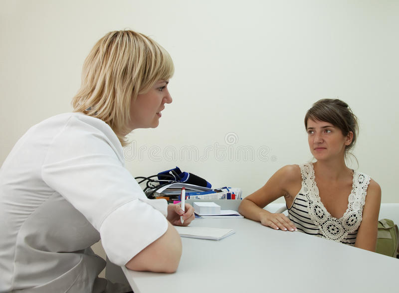 Patient listening the doctor stock photos
