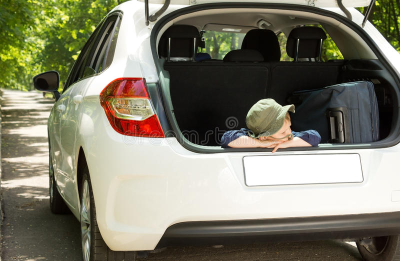 Patient little boy ready to leave on holiday
