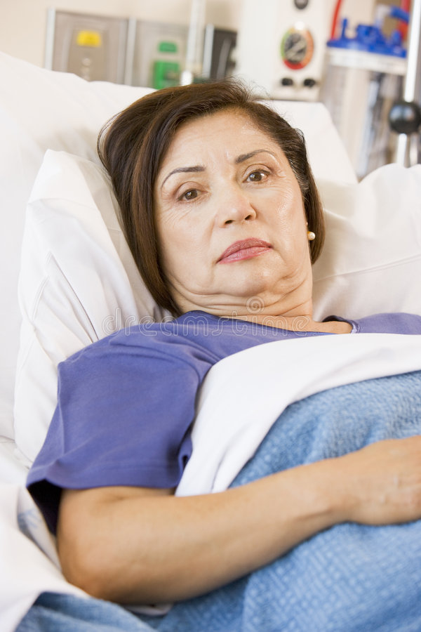Patient Lying In Hospital Bed stock photography