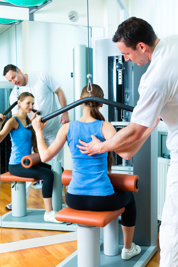 Patient at the physiotherapy doing physical therapy stock images