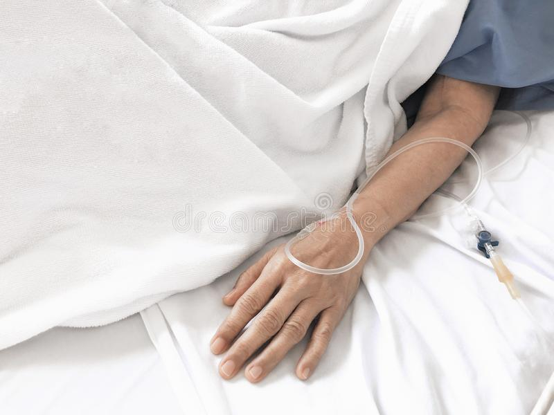 Patient receiving treatment, iv fluid intravenous drop saline drip in hospital room. Cancer. Chemotherapy stock image