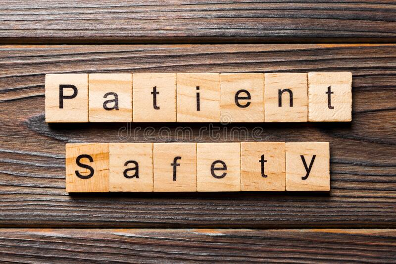 Patient Safety word written on wood block. Patient Safety text on wooden table for your desing, concept.  stock image