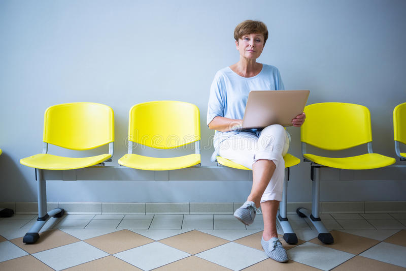 Patient sitting with report in a waiting room. Of a hospital stock photography