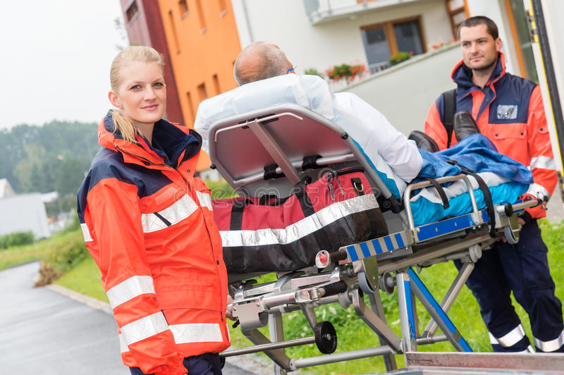 Download Patient On Stretcher With Paramedics Emergency Aid Stock Photo - Image: 26818298