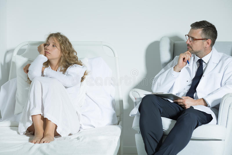 Patient talking with a psychiatrist stock photography