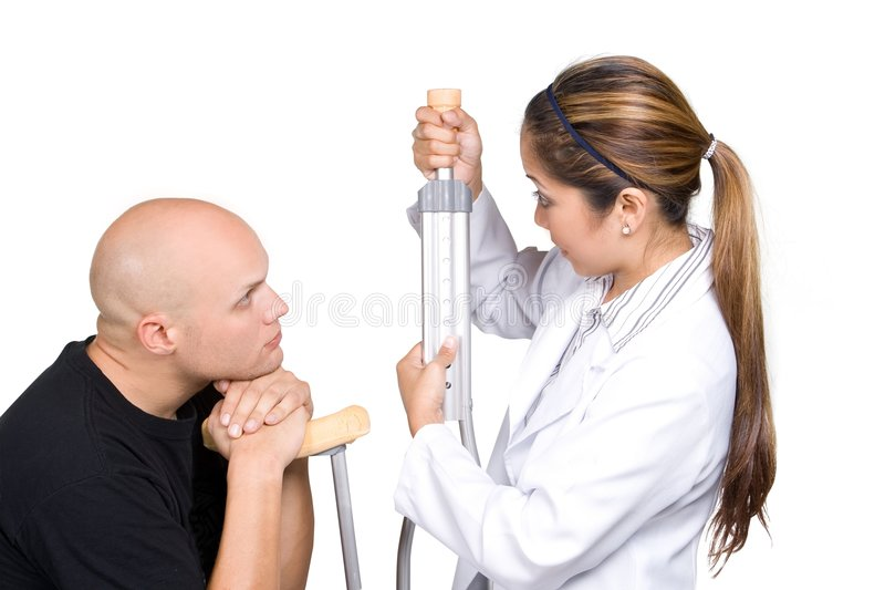 Patient Teaching. Physical therapist teaches patient on how to use personal crutches royalty free stock images