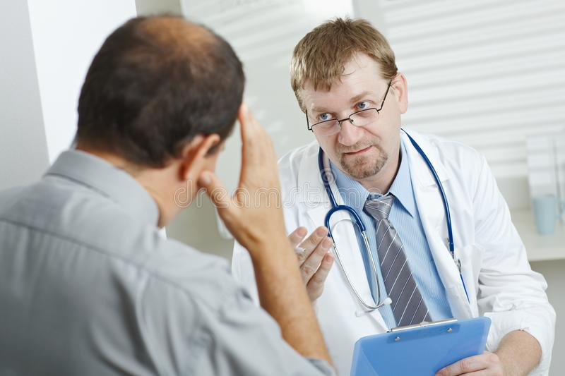 Patient telling symptoms to doctor royalty free stock images