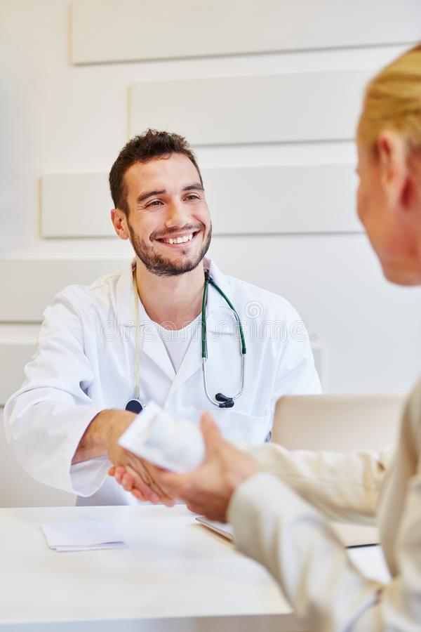 Patient trusts doctor and gives handshake stock image