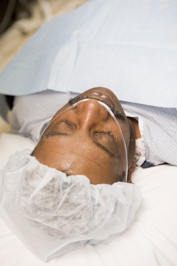 Patient Under Anaesthetic In Operating Theatre. Male Patient Under Anaesthetic In Operating Theatre royalty free stock photography