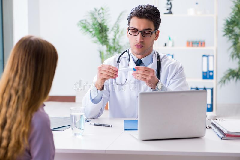 Patient In A Examination By Doctor In Clinic Stock Photos