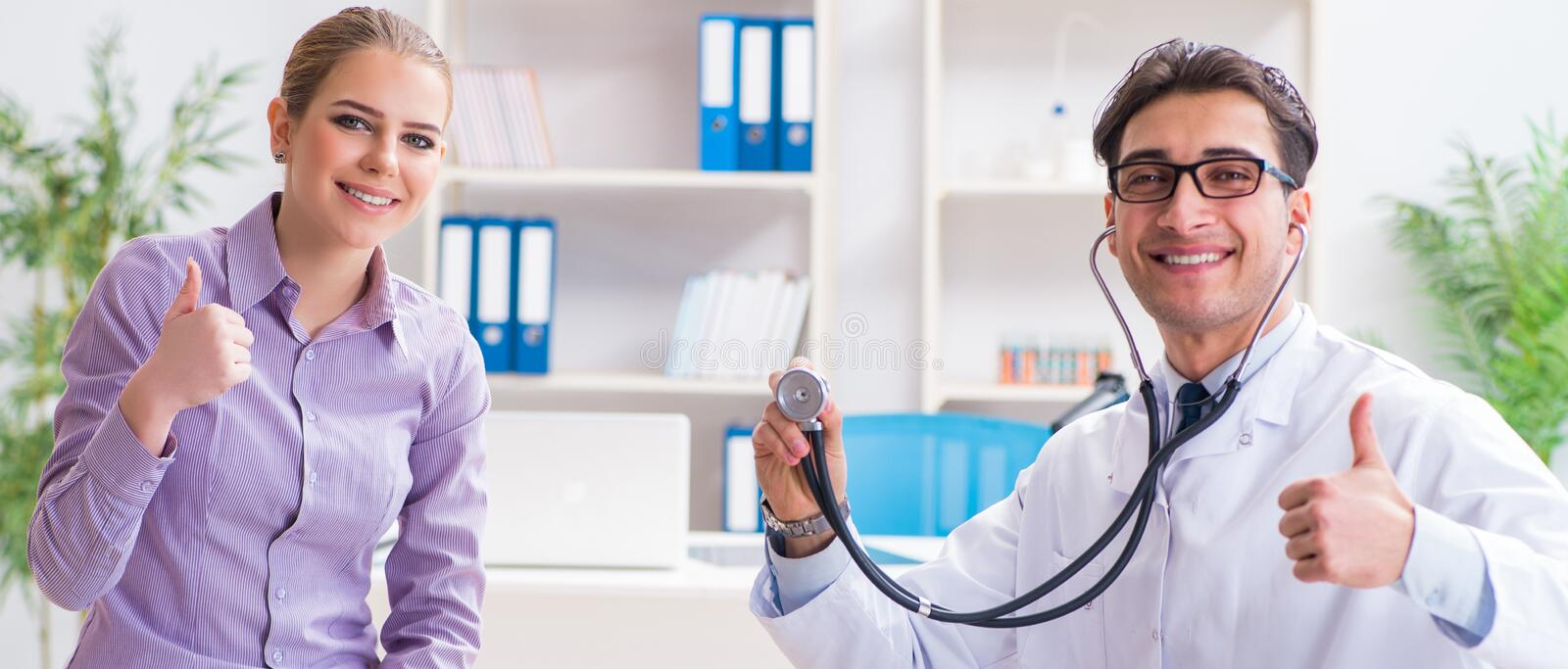 Patient visiting doctor for medical check-up in hospital stock photography