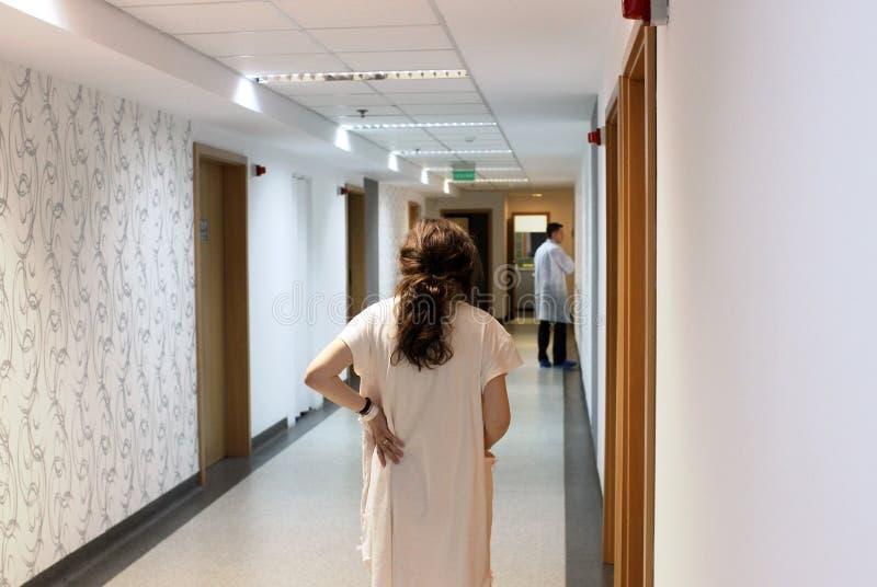 Patient walking in hospital hallway stock image