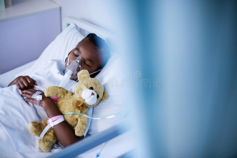 Patient wearing oxygen mask while sleeping royalty free stock photo