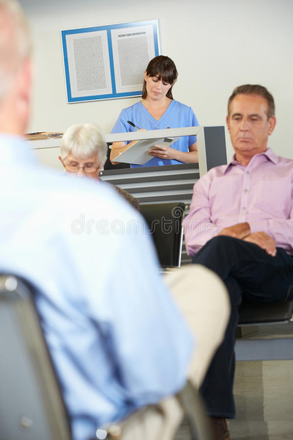 Download Patients In Doctor's Waiting Room Stock Photo - Image: 28179910
