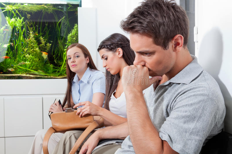 Patients In Doctor's Waiting Room royalty free stock photography