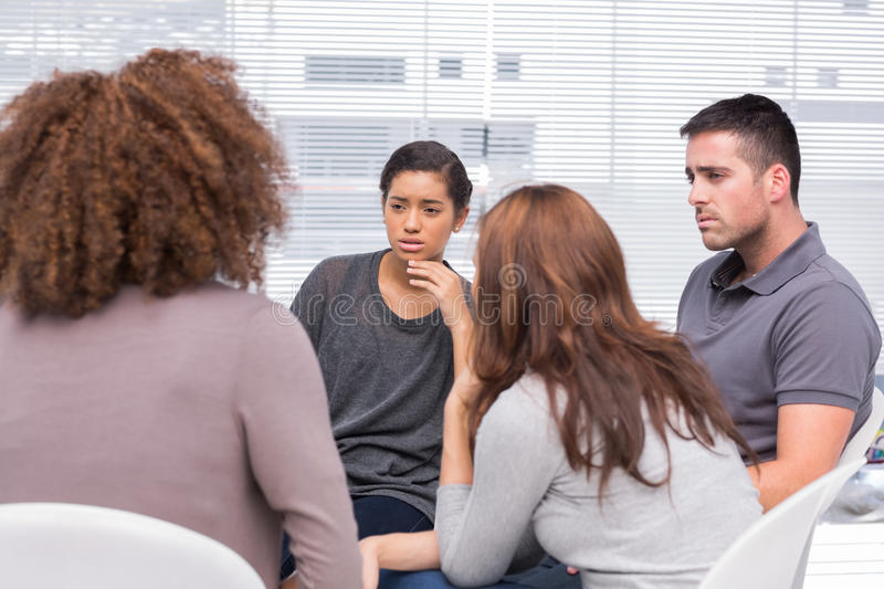 Patients listening to another patient stock image