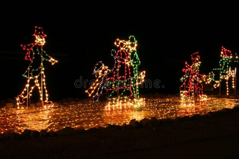 Patinage de lumières de Noël photos stock