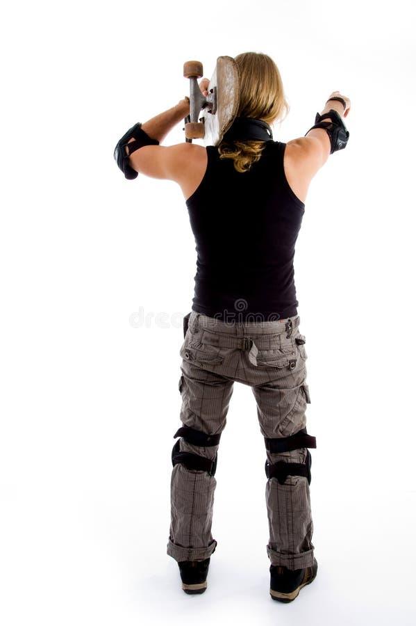 patineur mâle arrière de pose photo libre de droits