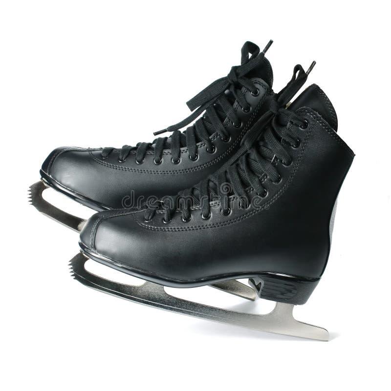 Patins pour le patinage de glace d'isolement sur le blanc images libres de droits