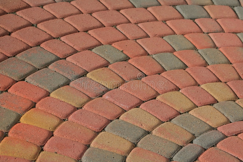 Patio Brick Pattern. Patio bricks in semi circular pattern with warm color tone stock photography